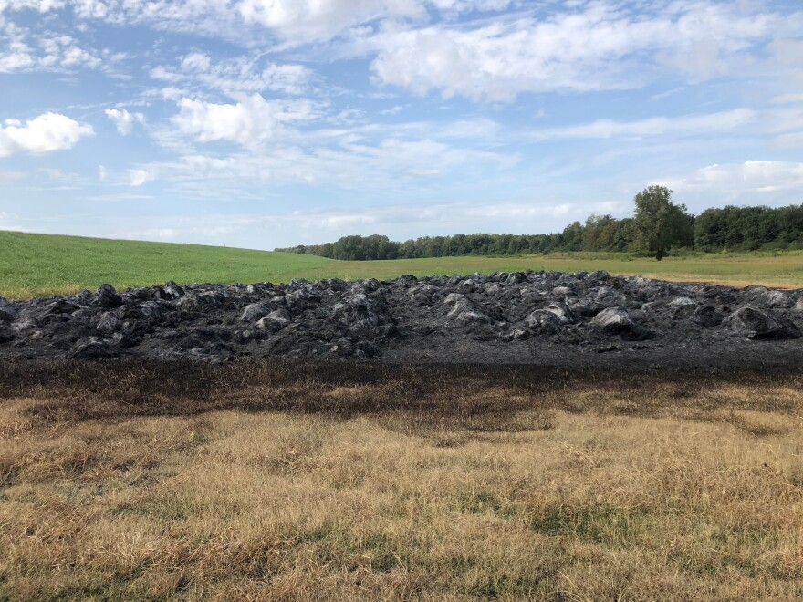 Vandals struck Terry Fuller's farm a few days ago, burning 367 stacks of hay. Fuller is trying to limit use of a herbicide called dicamba, which has pitted farmers against each other.
