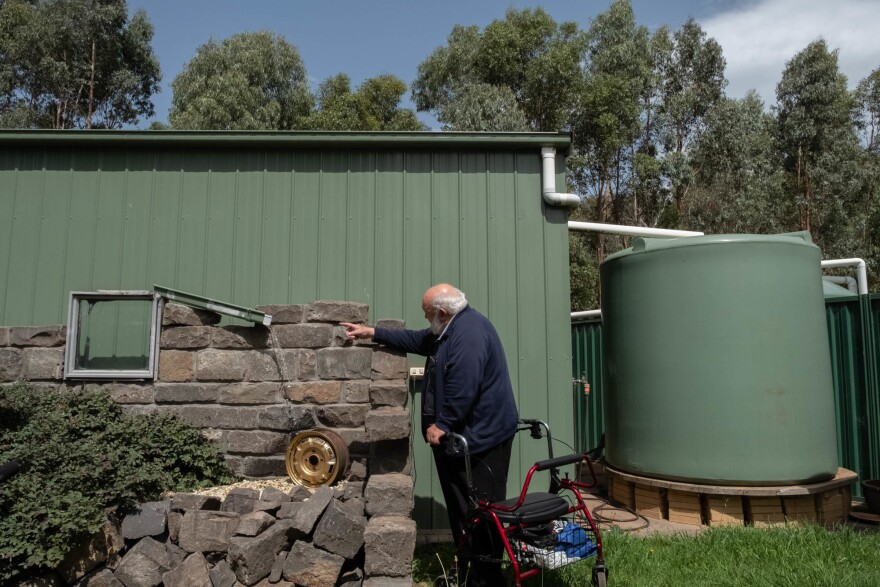 Behind his house, Milbourne added two large water tanks to help battle future fires.
