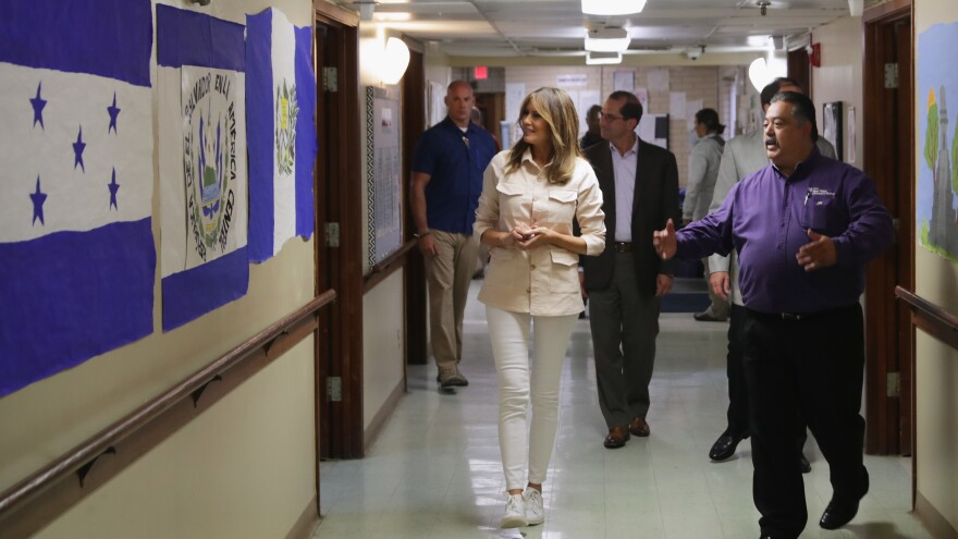 First lady Melania Trump walks through the Upbring New Hope Children's Center in McAllen, Texas, Thursday after a roundtable discussion with doctors and social workers there. The facility is operated by Lutheran Social Services of the South.