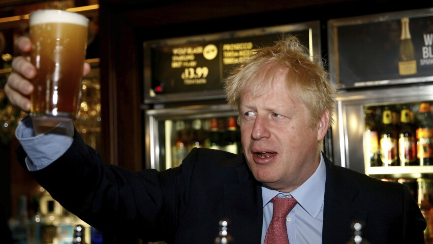 Conservative Party leadership candidate Boris Johnson, seen in a bar in London on Wednesday, stopped short of supporting Kim Darroch, which many analysts believe led the ambassador to resign.