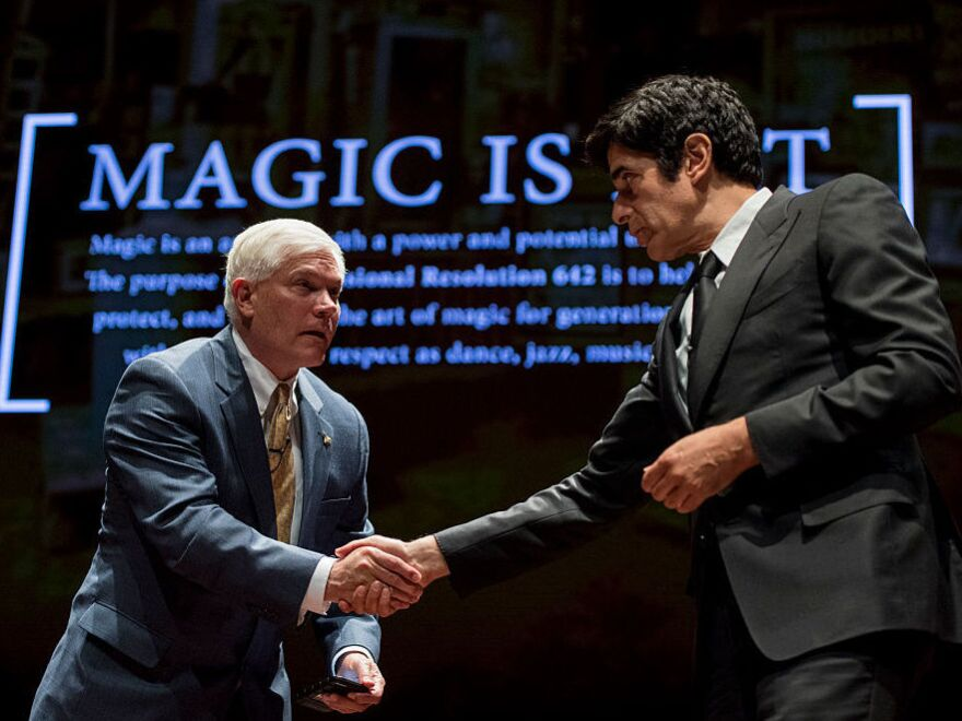 Texas Rep. Pete Sessions, left, shakes hands with magician David Copperfield at the U.S. Capitol during their event to push a resolution to recognize magic as an art form on Thursday, June 9, 2016.