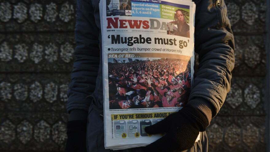 A newspaper headline calls for the defeat of Zimbabwean President Robert Mugabe on the eve of elections in Zimbabwe on Tuesday in Harare.