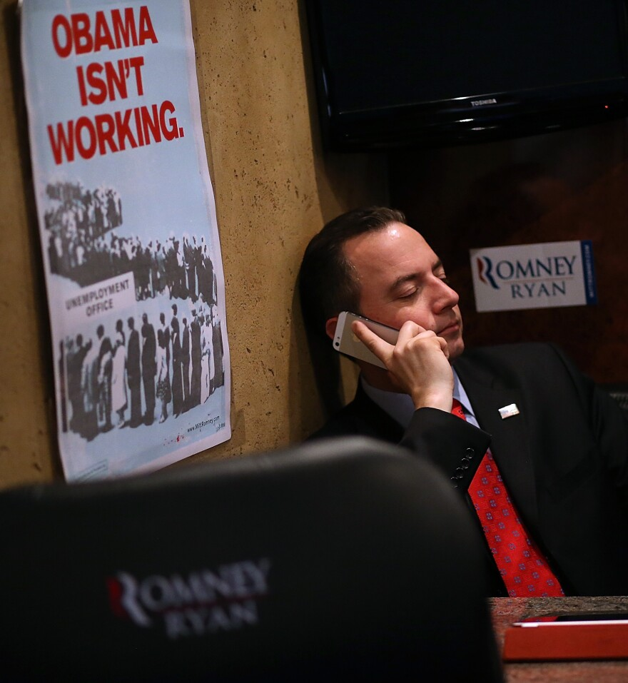 Republican National Committee Chairman Reince Priebus rides the Mitt Romney campaign bus days before the presidential election. Despite Romney's loss and other GOP failures, Priebus, who helped the party raise huge sums of money in 2012, may seek a second term.