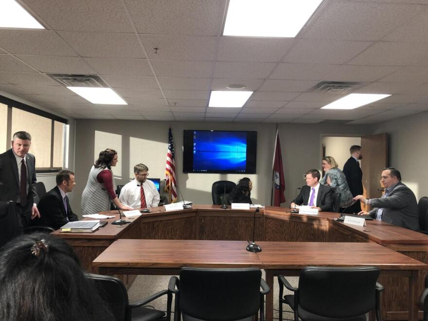 Members of the Arkansas Medical Marijuana Commission prepare to discuss the results of an outside consultant's grading of dispensary applications.