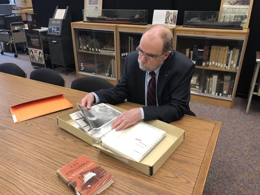 photo of bill barrow examining images