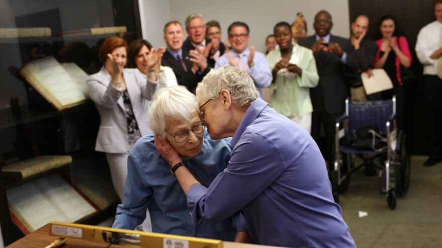 Phyllis Siegel (right) kisses her wife, Connie Kopelov, after the two exchanged vows at the Manhattan City Clerk's office. The couple were the first same-sex pair to tie the knot in New York City after the state's Marriage Equality Act went into effect on July 24.