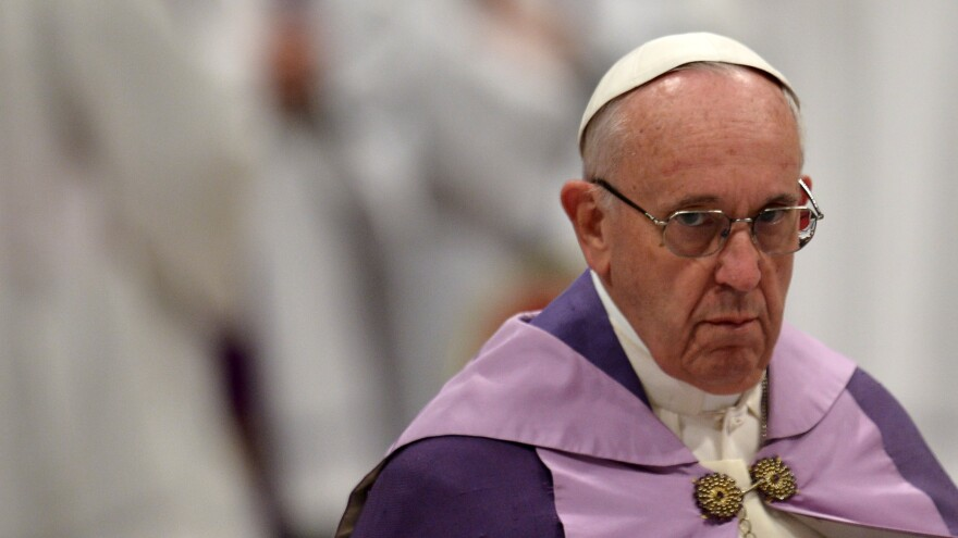 Pope Francis looks on during a penitential ceremony on March 4 at St. Peter's Basilica in Vatican City. Francis has imposed new financial rules on those working to promote the canonization of potential saints.