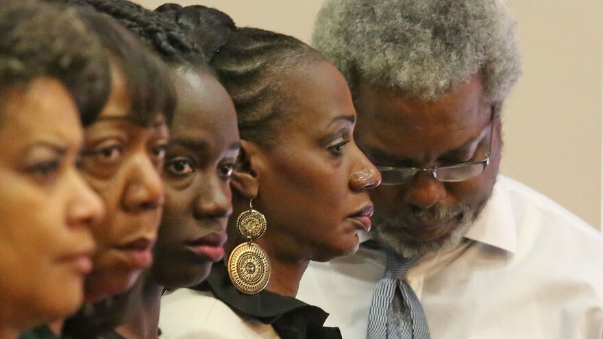 Pam Champion (second from right) and Robert Champion Sr. (right), parents of Robert Champion Jr., listen as the guilty verdict against Dante Martin is read in an Orlando courtroom on Friday.