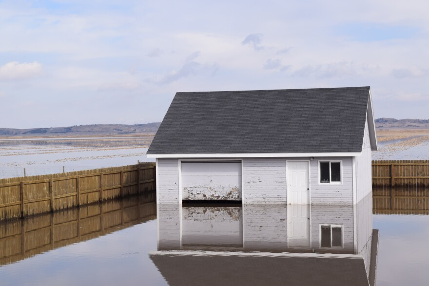 "Hornick resident Dale Ronfeldt's garage in water in March 2019. A reporter joked with him that he had ""lakefront property"" and Ronfeldt joked, ""you want to buy some?"""