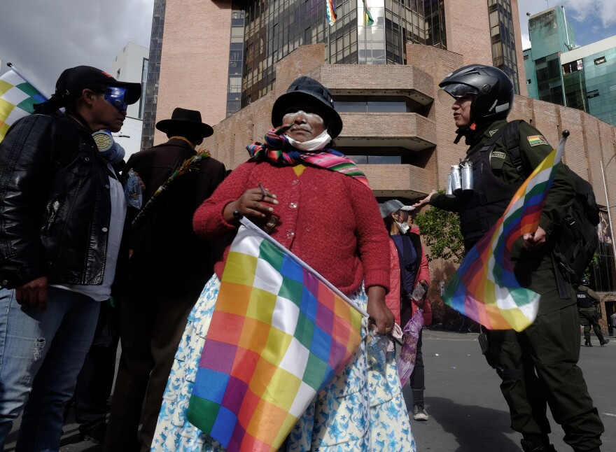 A Bolivian woman smokes after being attacked by teargas used by the police to control and suppress the protest. Bolivians went to the streets to call for the resignation of interim president Jeanine Añez Chávez in November, 2019.