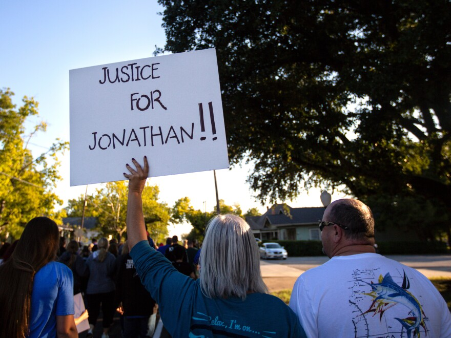 People gather for a march, rally and candlelight vigil in honor Jonathan Price in Wolfe City, Texas, on Monday. Wolfe City police officer Shaun Lucas has been charged in relation to the fatal shooting.
