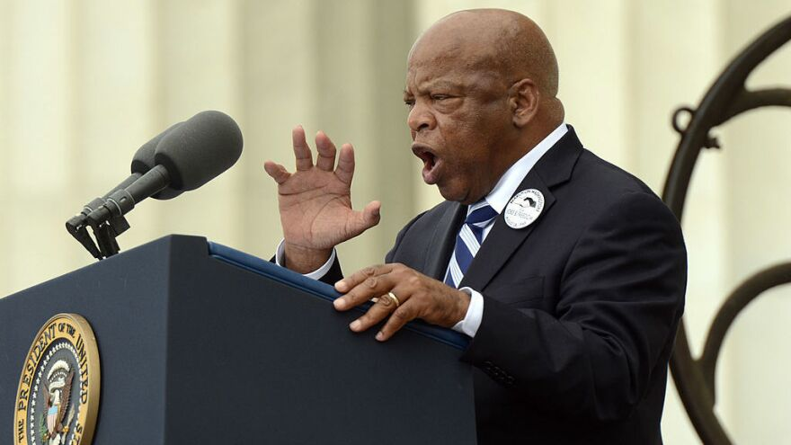 "Civil rights leader and Rep. John Lewis, D-Ga., delivers remarks in front of a freedom bell during the ""Let Freedom Ring"" commemoration event in 2013."