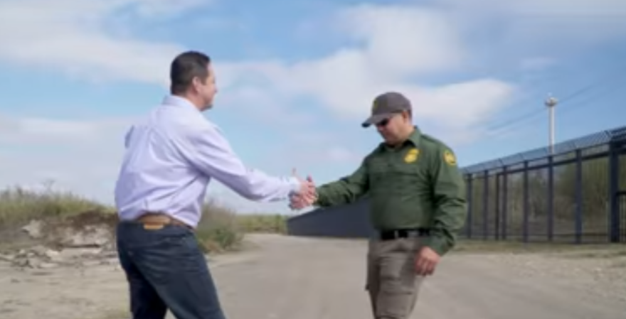 A screenshot of a campaign commercial featuring Tony Gonzales with a fake Border Patrol agent.