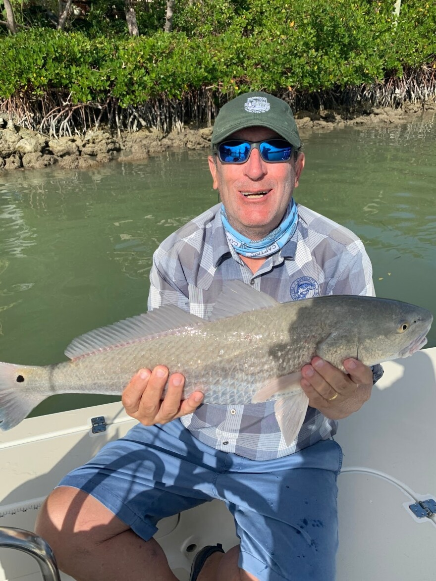 David Blanchflower caught a big fish, and he's happy about it.