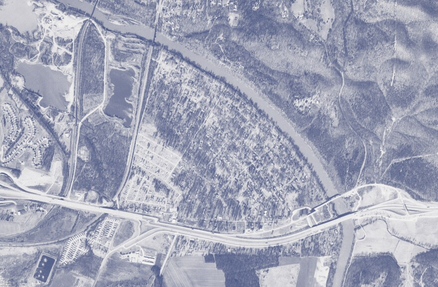 A satellite image from the U.S. Geological Survey shows homes and other buildings in Times Beach in 1990.