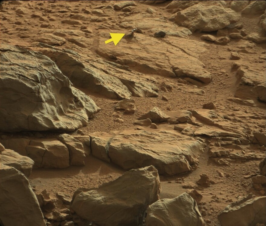 The image, taken by Mars rover Curiosity in January has sparked debate because of the shiny object marked by the yellow arrow.
