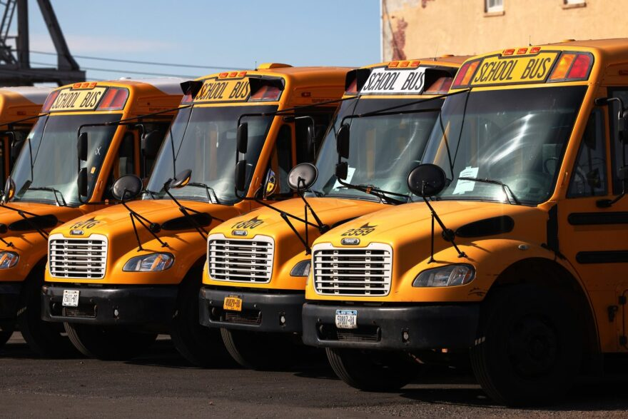 School buses are parked at a bus depot in the Red Hook neighborhood of Brooklyn in New York City. Mayor Bill de Blasio closed all New York City public schools for in-person learning after NYC hit a 3 percent coronavirus positivity rate on a seven-day rolling average.