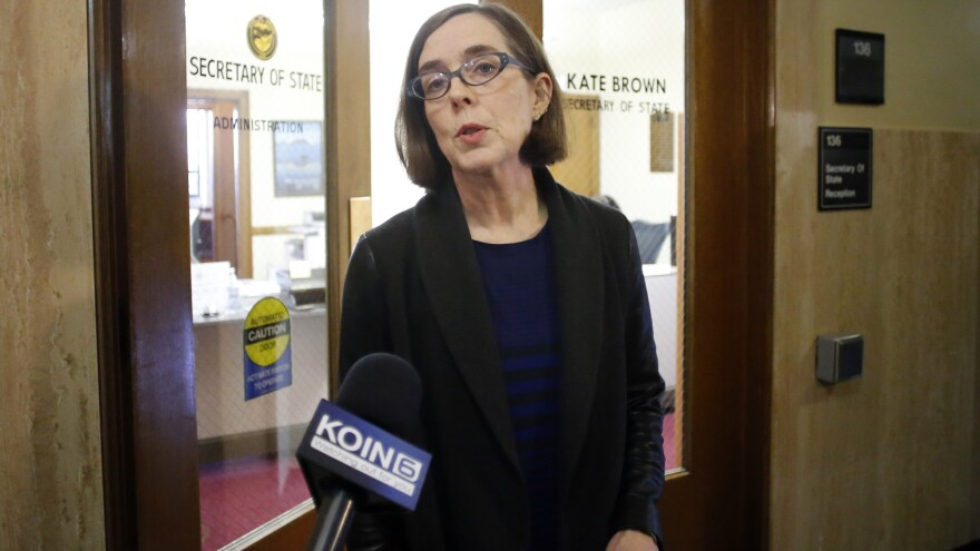 Oregon Secretary of State Kate Brown speaks to the media outside of her office at the Oregon Capitol in Salem, Ore., last Friday. Brown will take over as governor after John Kitzhaber announced his resignation on Friday amid a growing ethics scandal involving his fiancee, a green-energy consultant accused of using her relationship with the governor to land contracts for her business.