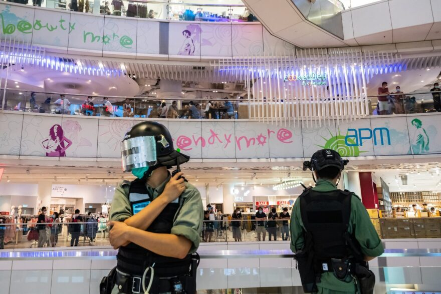 Riot police stand guard during a clearance operation during a demonstration in a mall in Hong Kong, China. Hong Kongers are finding creative ways to voice dissent as police began making arrests for people displaying now forbidden political slogans. (Photo by