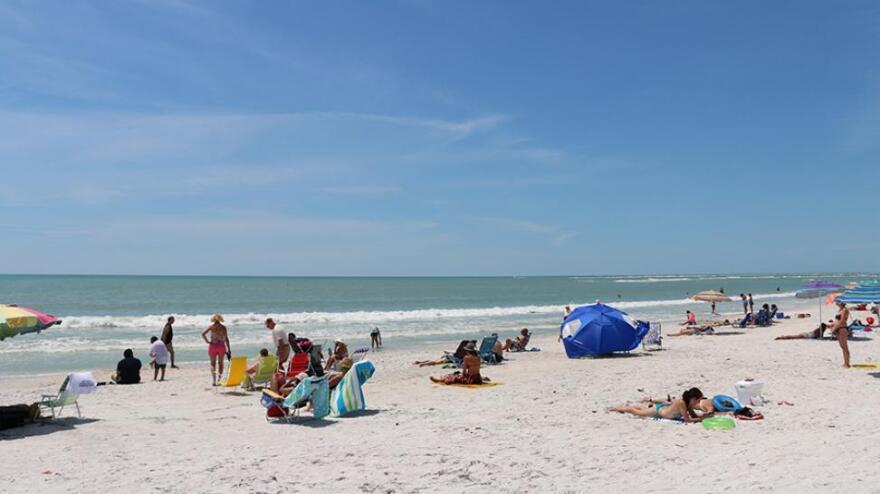 A beach with people sunbathing