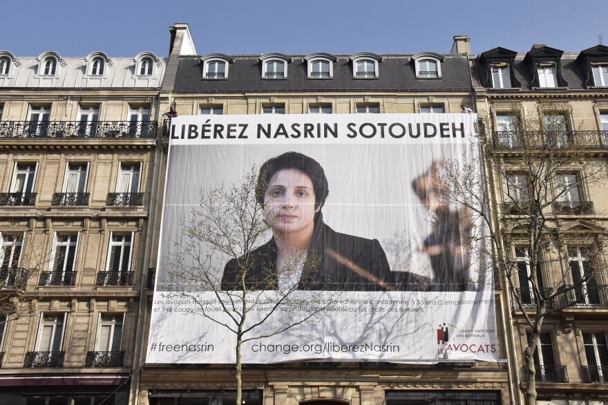 A large banner in support of Iranian human rights lawyer Nasrin Sotoudeh is displayed in Paris in 2019. Sotoudeh is serving a 38-year prison sentence in Iran. Her health has declined after a five-week hunger strike.