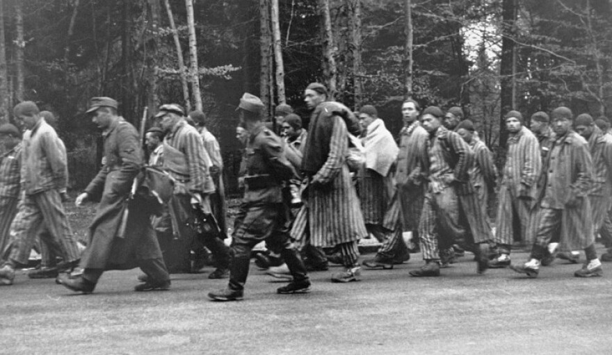 Nazi guards force Jewish prisoners on a death march during World War II. The fifth man from the right is Leo Wolfe, who survived the Holocaust and co-founded the Holocaust Museum & Learning Center with Tom Green and Bill Kahn.  4/15/19