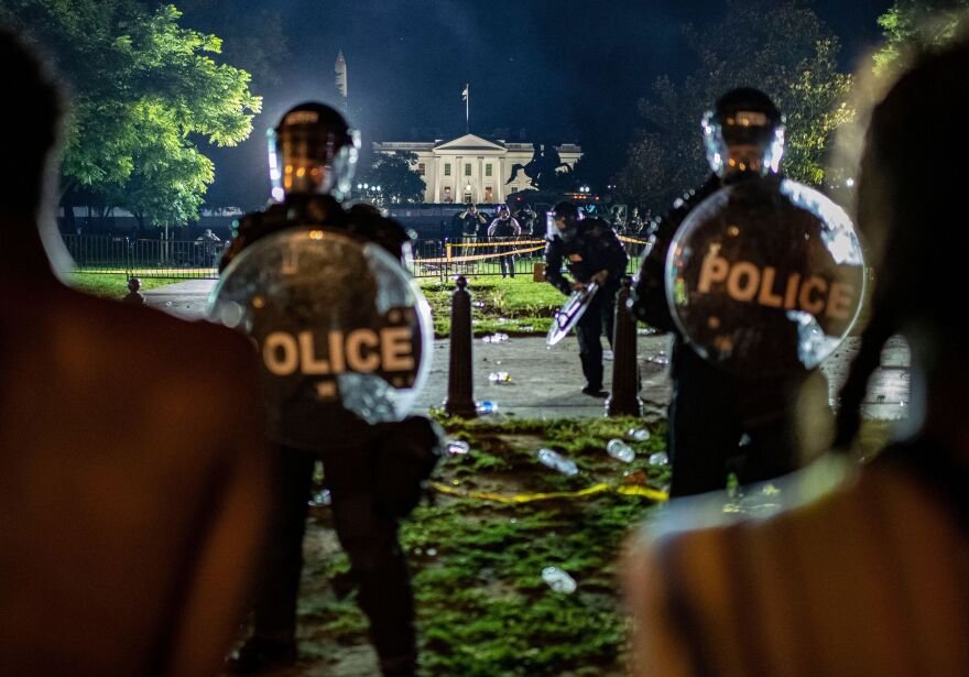 Demonstrators confront secret service police and Park police officers outside of the White House on May 30, 2020 in Washington D.C.