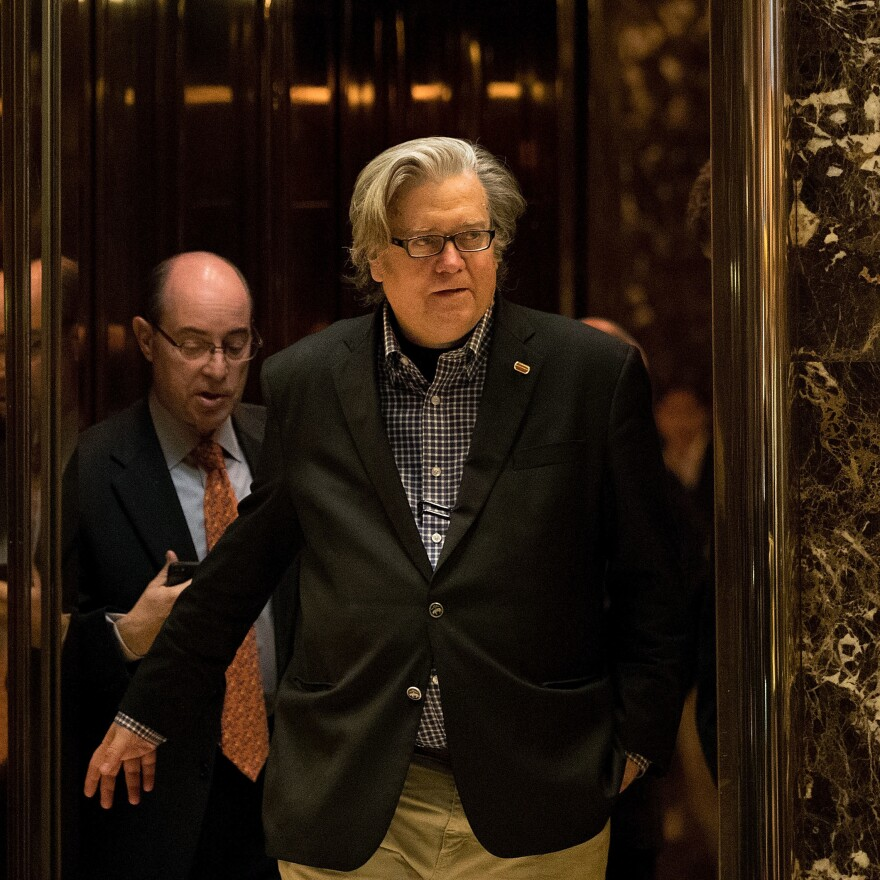 Steve Bannon exits an elevator in the lobby of Trump Tower on Friday. He has been newly named the chief strategist of the Trump White House.