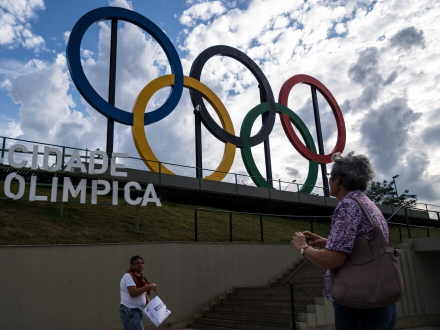 A woman takes pictures of the Olympic rings at Madureira Park, the third largest park in Rio de Janeiro.