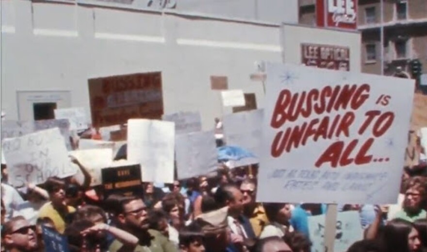 Under federal desegregation oversight, Dallas schools implemented a busing program in the 1970s. Protests ensued like this one in 1971, captured from archival WFAA TV video.