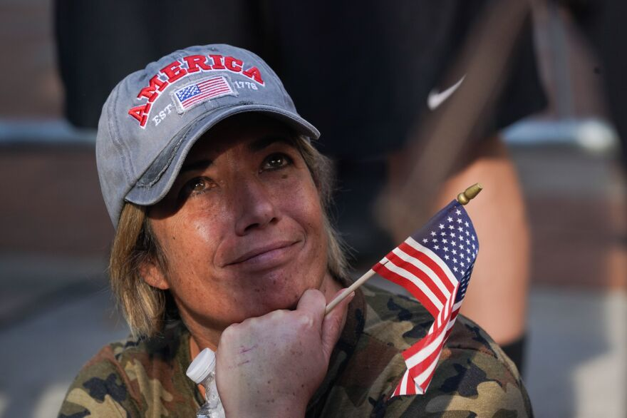 A crestfallen Trump supporter looks on outside the Pennsylvania Convention Center in Philadelphia Saturday after Joe Biden was declared winner of the 2020 presidential election.