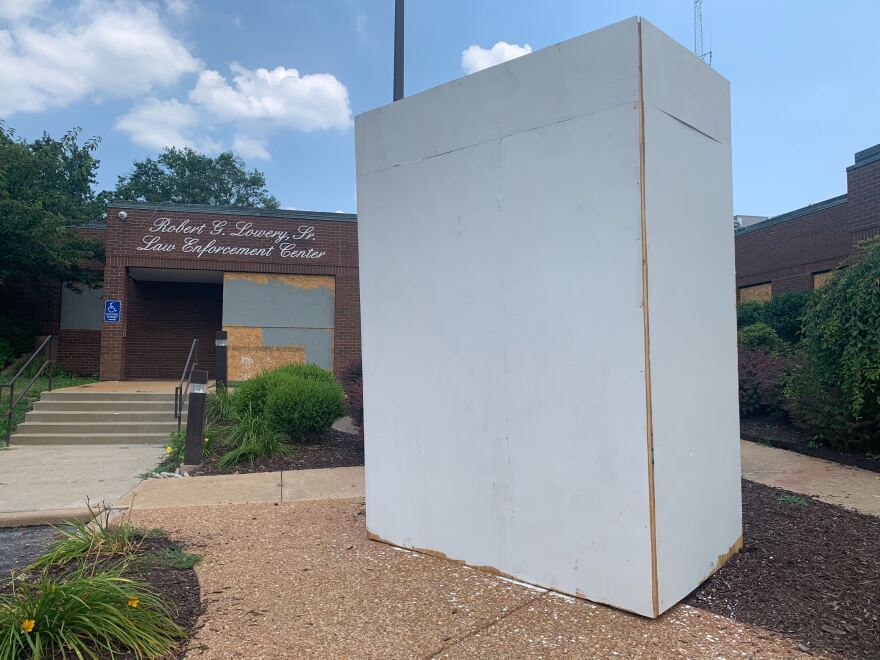 By Monday afternoon, the Florissant Police Department painted over protesters' hand-written demands and mantras on the plywood box that protects a statue.  7/6/2020