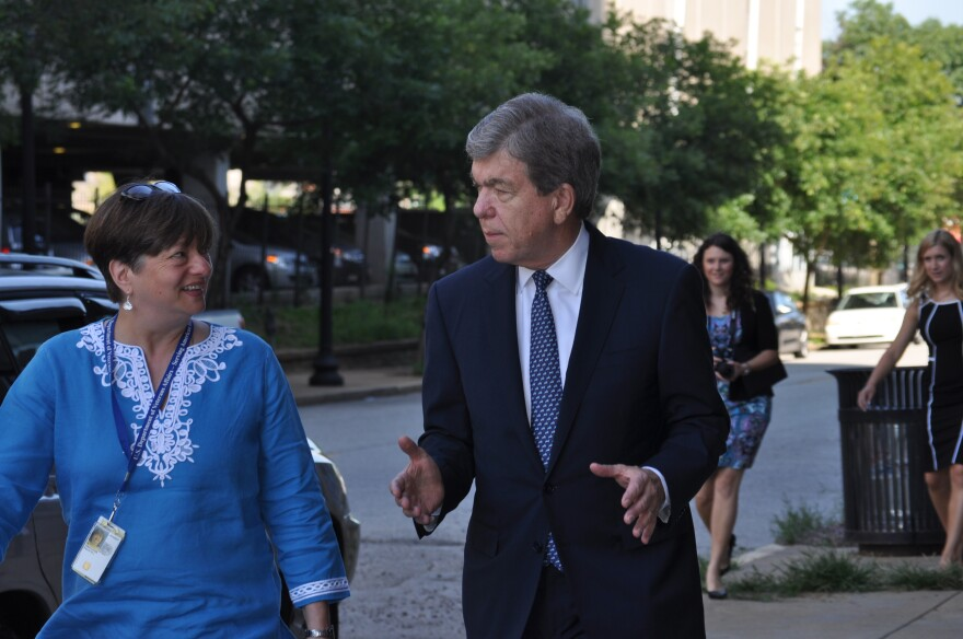 After meeting with female veterans and healthcare providers, Blunt walks to the VA Women's Clinic in St. Louis.