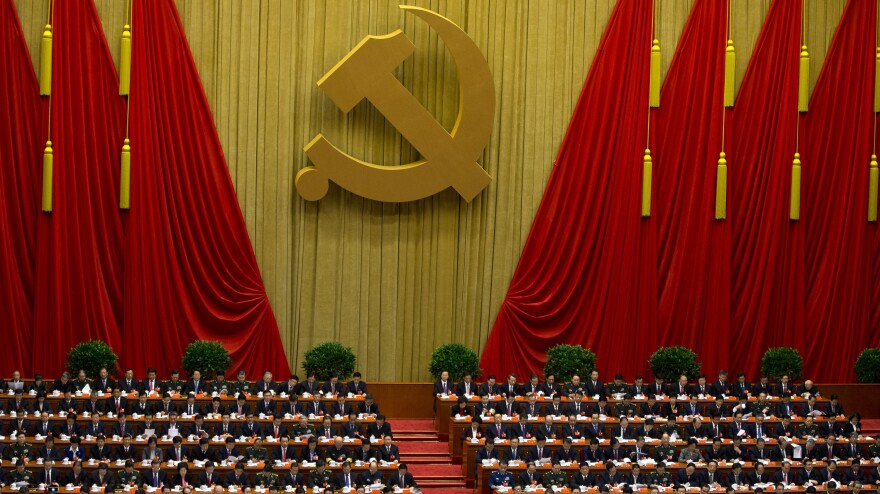 Chinese Communist Party leaders attend the opening session of the 18th Communist Party Congress at the Great Hall of the People in Beijing, on Thursday. The meeting marks the beginning of a once-in-a-decade transfer of power.