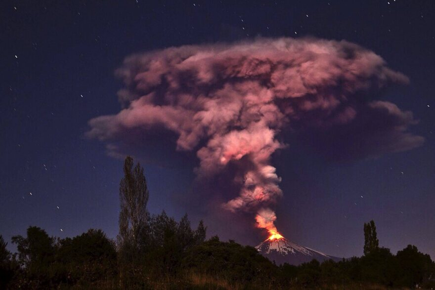 Villarrica volcano erupts on Tuesday. More than 4,000 people have been evacuated as snow melt caused by the eruption has led to the risk of flooding