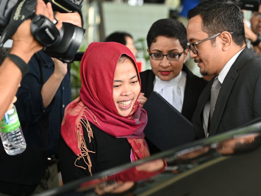 Indonesian national Siti Aisyah smiles while leaving the Shah Alam High Court, outside Kuala Lumpur on March 11.