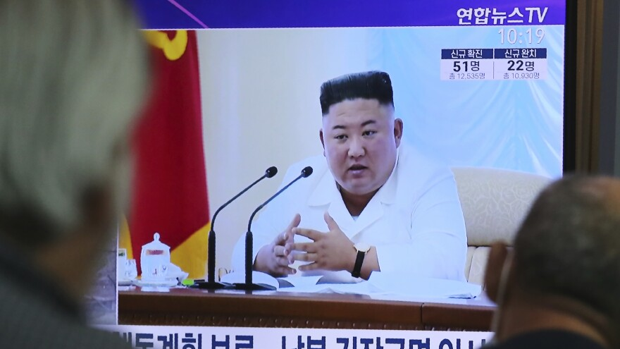 North Korean leader Kim Jong Un appears in a TV news program watched by people in Seoul, South Korea, on June 24.