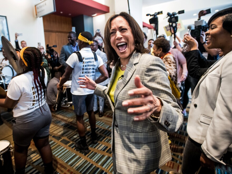 Sen. Kamala Harris dances with a marching band upon arrival at the South Carolina Democratic Party Convention in June 2019, when she was a presidential candidate in the Democratic primary race.