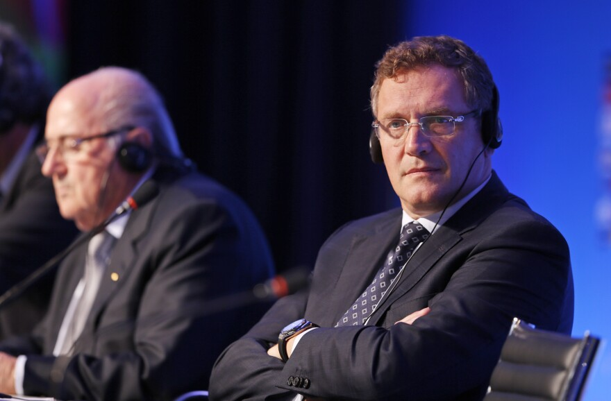 FIFA Secretary-General Jérôme Valcke (right) and FIFA President Joseph Blatter attend a press conference in 2014.
