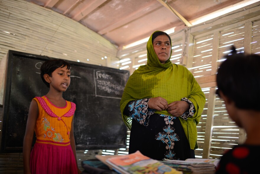 Nila Khatun, age 8, and her teacher, Mafya Begum, during a lesson on the floating school.