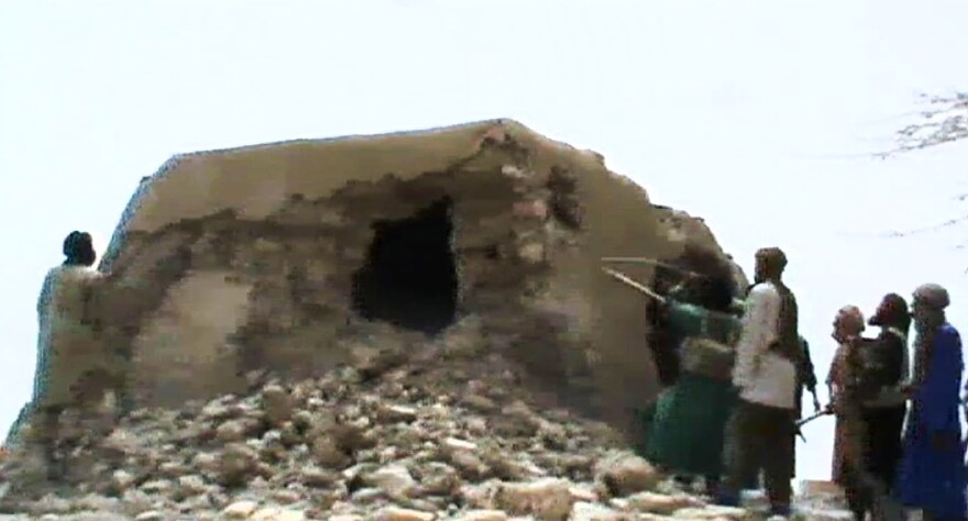 A still from a video shows Islamist militants destroying an ancient shrine in Timbuktu on July 1, 2012. At the time, the International Criminal Court warned that their campaign of destruction was a war crime. The hardline Islamists considered the shrines to be idolatrous.