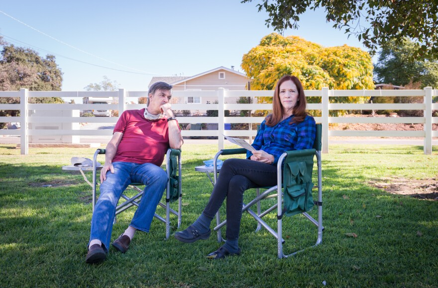 Michael and Lorraine Rogge sit outside their RV in El Cajon, California. Lorraine received a bill for more than $12,000 for a bundled lab test from Carlsbad Medical Center; her share was over $3,000.