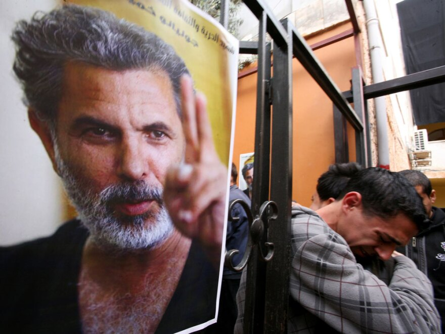 Palestinian  youths mourn the death of Juliano Mer Khamis  outside the Freedom Theatre in Jenin refugee camp in the West Bank on Apr. 5.