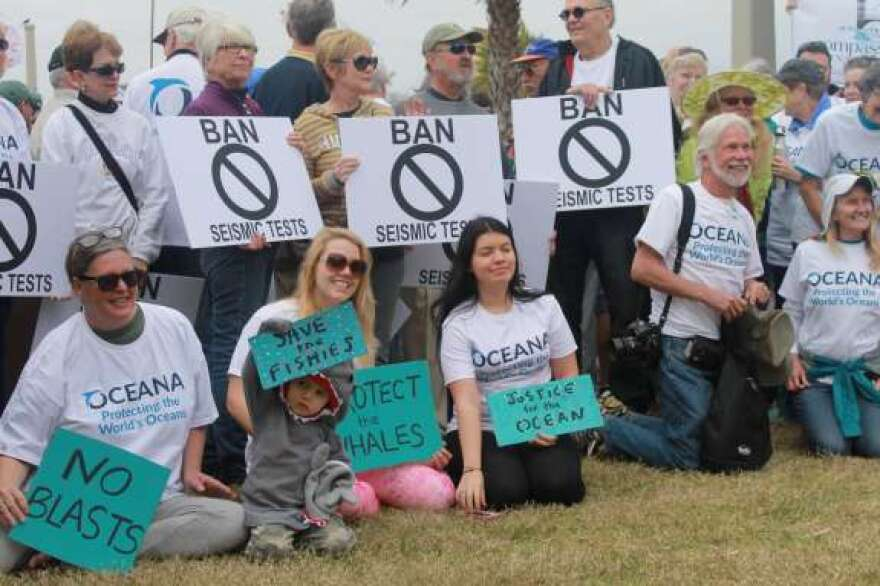 Opponents in St. Augustine of oil and gas exploration hold signs