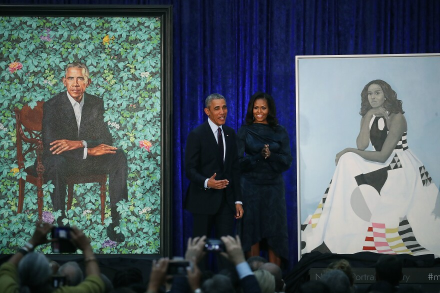 Former President Barack Obama and former first lady Michelle Obama stand next to their newly unveiled portraits during a ceremony at the Smithsonian's National Portrait Gallery on Feb. 12, 2018. The portraits are set to go on a yearlong tour to five cities in June of 2021.