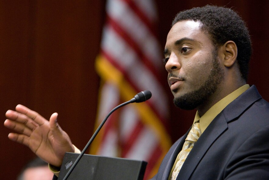 In this Nov. 5, 2009 file photo, Reginald Dwayne Betts, writing workshop program director, speaks during a school forum on Capitol Hill in Washington, D.C. Betts, a convicted felon who graduated from Yale Law School and won acclaim as a poet, was admitted to the state bar Friday, Sept. 29, 2017, by the Connecticut Bar Examining Committee.