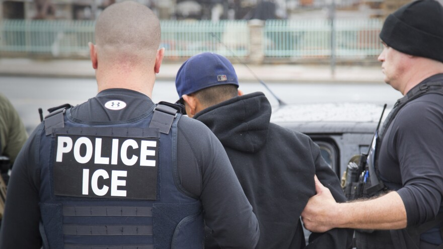 ICE agents make an arrest in Los Angeles on Feb. 7, 2017. Shortly after taking office, President Trump passed an executive order criminalizing anyone in the country illegally.