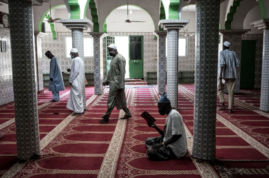 Muslim worshipers practice social distancing after mosques were reopened in Dakar on May 12.