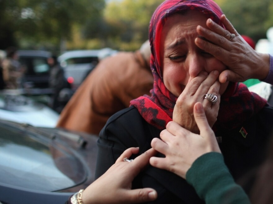 <p> A woman is overcome with emotion during celebrations outside the Libyan Embassy in London on Thursday, after the news that former Libyan leader Col. Moammar Gadhafi was killed after an assault on his hometown of Sirte.</p>