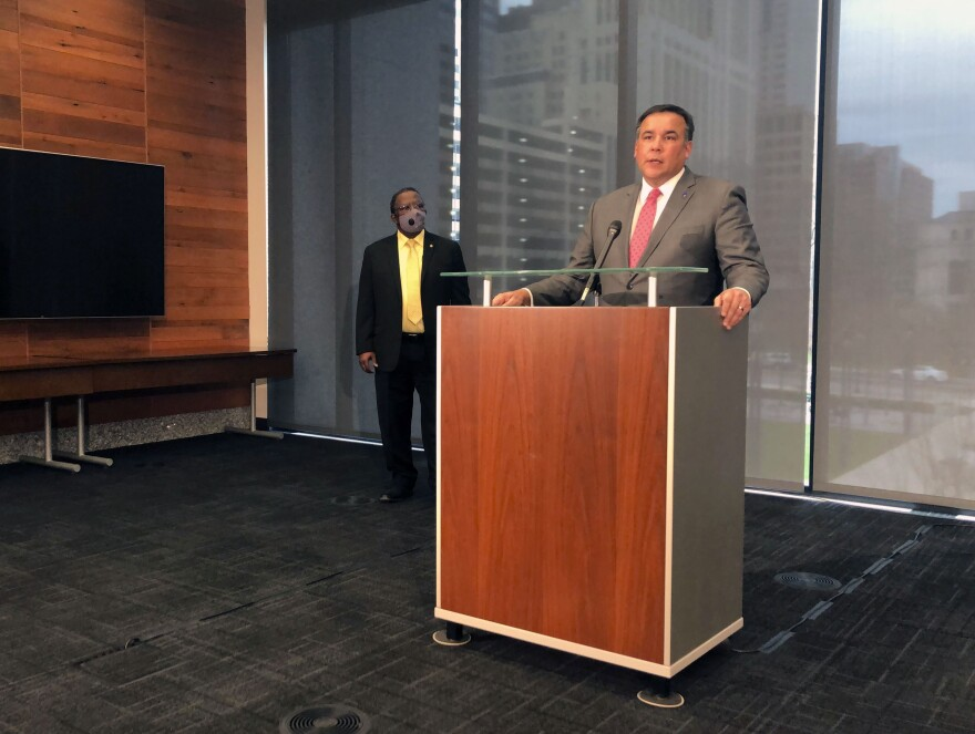 Columbus Mayor Andrew Ginther calls for the firing of Officer Adam Coy seen on body cam video shooting a Black man who was holding a cell phone, at a news conference on Wednesday, Dec. 23, 2020.